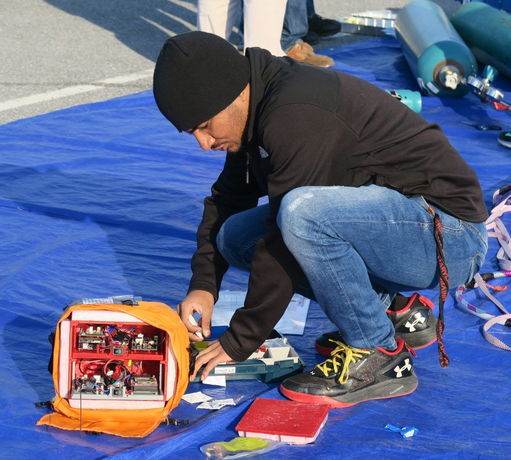 A University of Maryland student assembles a balloon payload prior to launch.