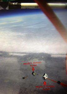 View from balloon downward showing HERMES and TrapSat payloads in flight.